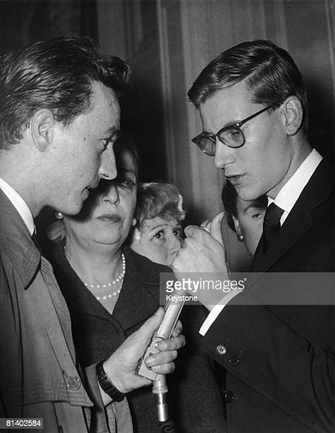 French fashion designer Yves Saint Laurent gives his first interview since succeeding the late Christian Dior, to a radio reporter in Paris, 1957.