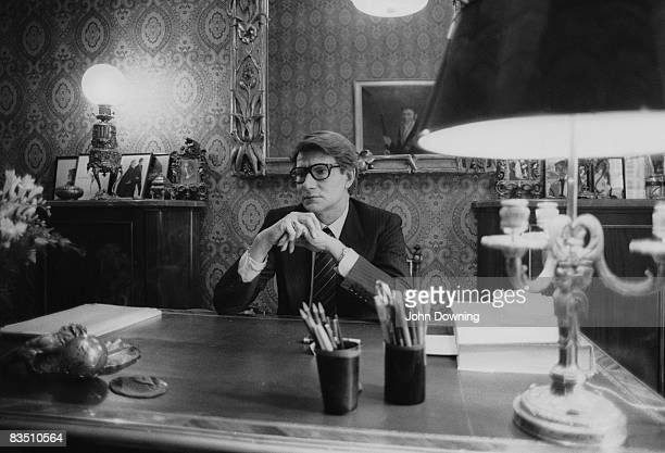 French fashion designer Yves Saint Laurent in the office of his Paris studio, January 1982.