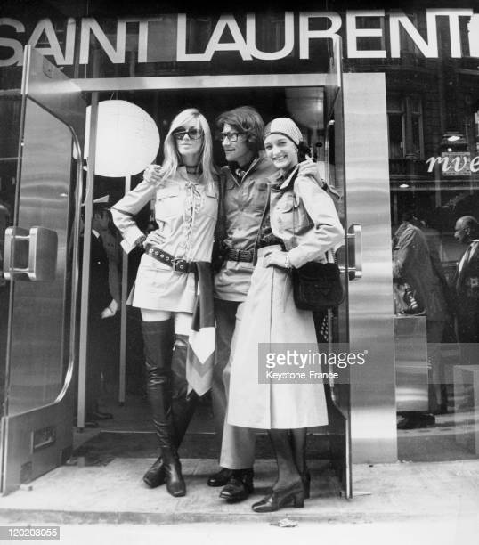 French fashion designer Yves Saint Laurent posing in front of his new shop in Bond Street on September 10 1969 in London United Kingdom He is with...