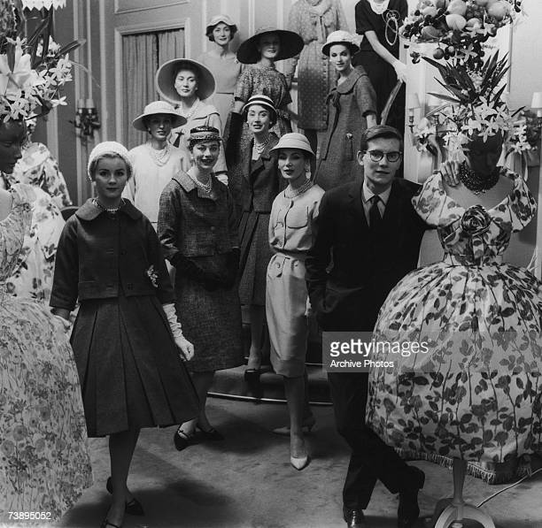 French fashion designer Yves Saint Laurent with a group of models circa 1960