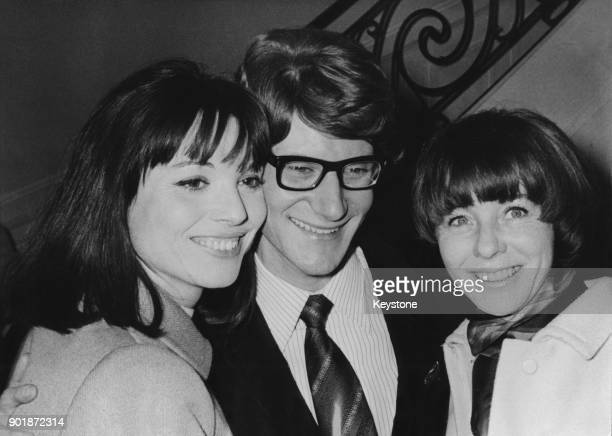 French fashion designer Yves Saint Laurent with fashion models Elsa Martinelli and Bettina Graziani after his SpringSummer 1966 fashion show in Paris...