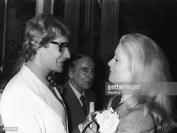 French fashion designer Yves Saint Laurent with French actress Catherine Deneuve after the launch of his new collection Paris 24th July 1974