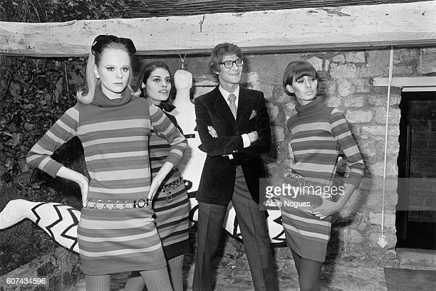 French fashion designer Yves Saint Laurent with three of his fashion models wearing minidresses during the inauguration of the first Yves Saint...