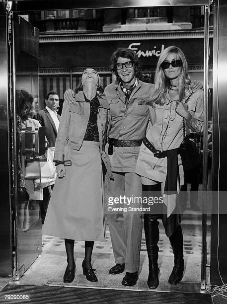 French fashion designer Yves SaintLaurent and models Loulou de la Falaise and Betty Catroux at the opening of SaintLaurent's new boutique 'Rive...