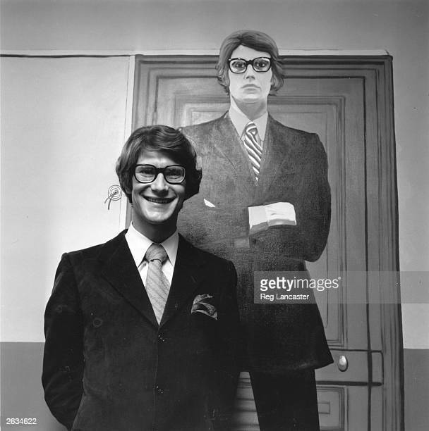 French fashion designer Yves St. Laurent, originally Henri Donat Mathieu in his Paris boutique with a replica dummy of himself.