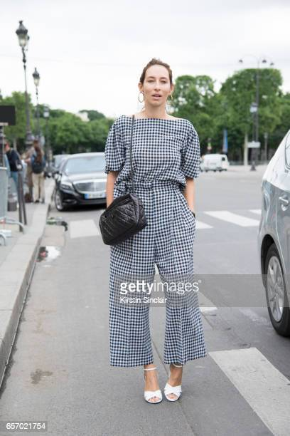 French fashion journalist Alexandra Golovanoff wears a Sonia Rykiel jumpuit and shoes and Chanel bag on day 3 of Paris Haute Couture Fashion Week...