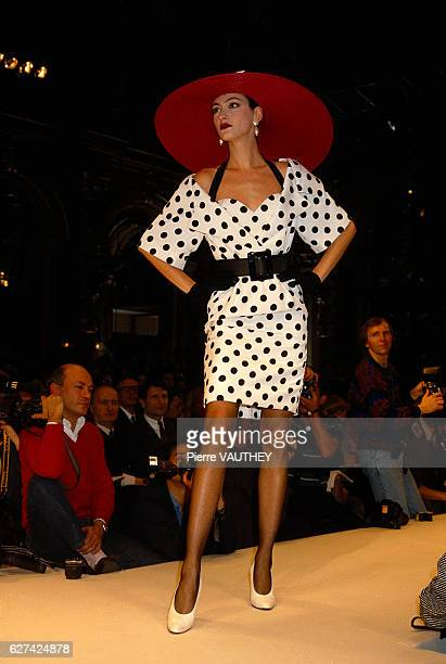 French fashion model Anne Rohart models the latest haute couture women's line by French fashion house Christian Dior at the 1987 SpringSummer fashion...