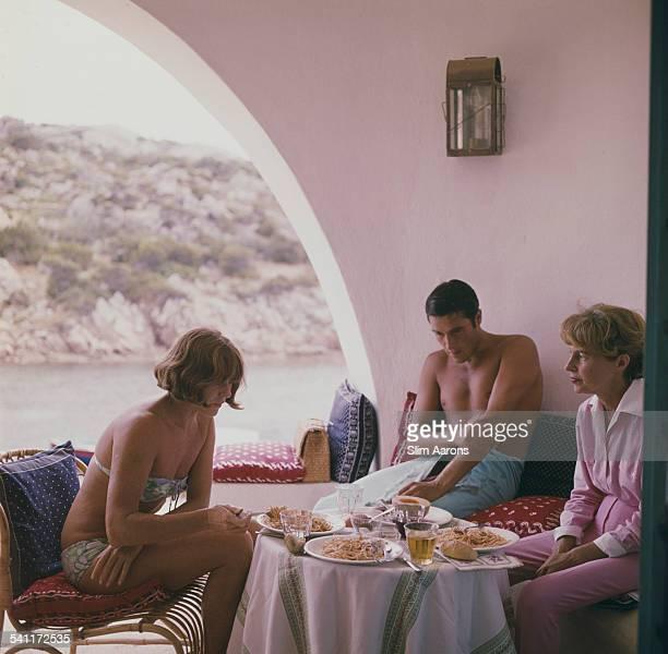 French fashion model Bettina Graziani eating with friends Costa Smeralda Sardinia Italy 1964