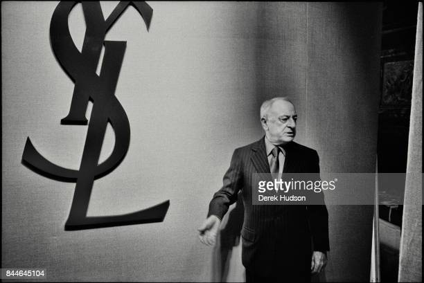 French fashion patron Pierre Berge stands in the wings at an Yves Saint Laurent haute couture runway show at the Hotel Meurice Paris France June 6...