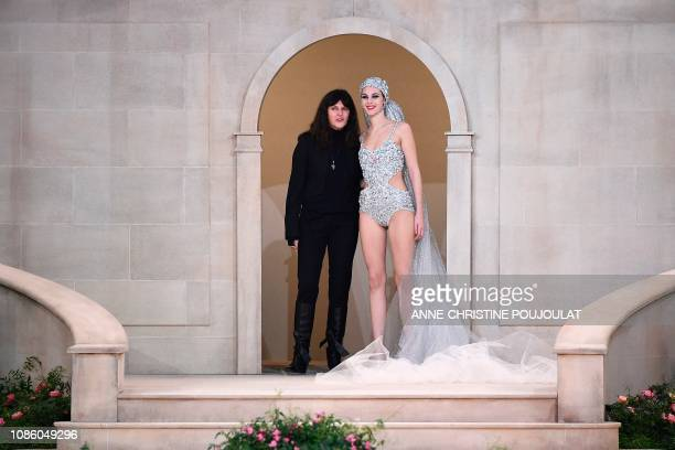 French fashion studio director of Chanel Virginie Viard flanked by Italian model Vittoria Ceretti acknowledges the audience at the end of the Chanel...