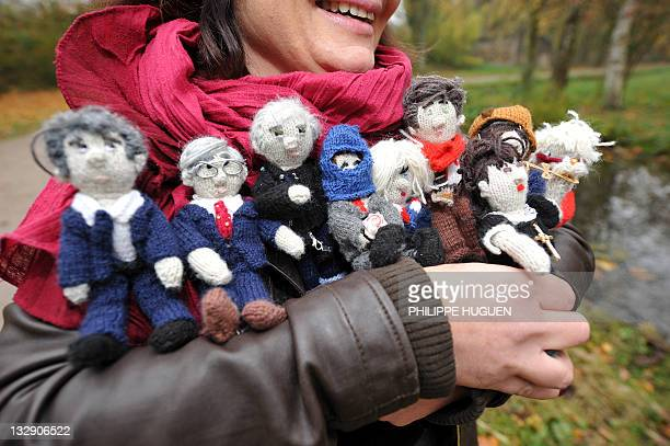 MICHEL French female blogger from Lille holds in her arms knitted figures featuring candidates for the 2012 French presidential election Francois...