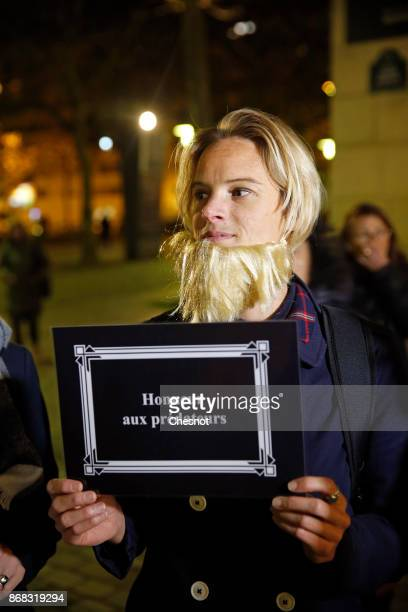 French feminist activist holds a placard reading 'honor to predators' during a demonstration against FrenchPolish director Roman Polanski in front of...