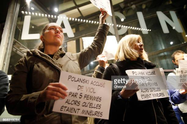 French feminist activist holds a placard reading 'Polanski accused of rape by 5 women who where then minors' during a demonstration against...