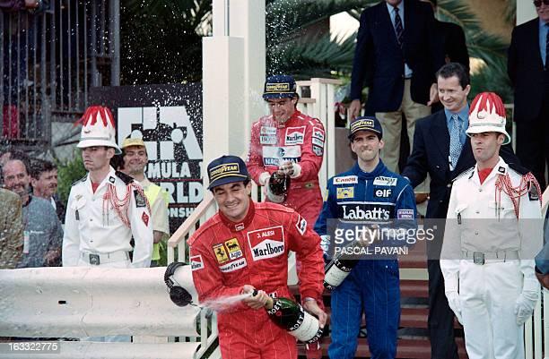 French Ferrari driver Jean Alesi British WilliamsRenault driver Damon Hill and Brazilian McLaren Ford driver Ayrton Senna spray champagne on May 23...