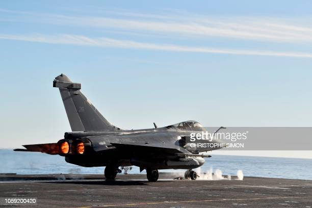 A French fighter jet Rafale takes off on the aircraft carrier 'Charles de Gaulle' after the completion of its 18 monthlong renovation in Toulon...