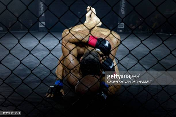 French fighter Karim Ghaji fights against Brasilian fighter Wallace Felipe during the first official Mixed Martial Arts fight in France, in...