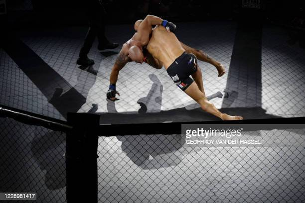 French fighter Pierre Rouvere fights against Armenian fighter Ben Zakar during the first official Mixed Martial Arts fight in France, in...