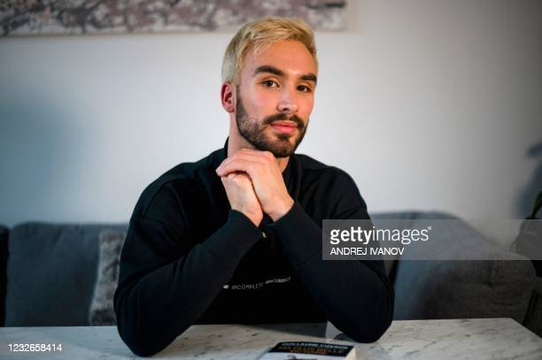 """French figure skater Guillaume Cizeron poses during an interview with AFP in his apartment in Montreal on April 30, 2021. - """"I am at peace with who I..."""