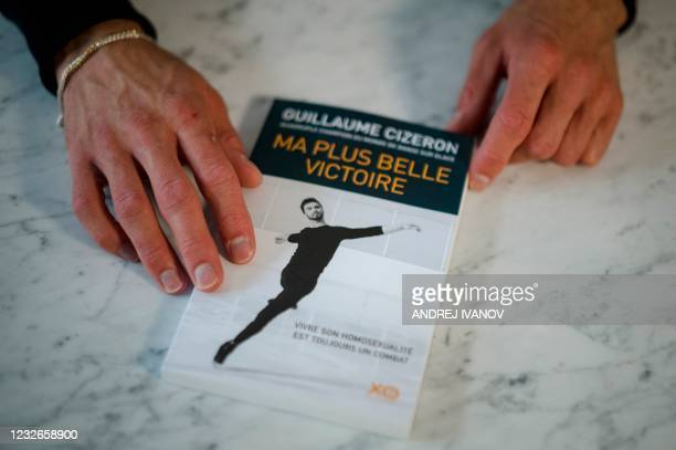 "French figure skater Guillaume Cizeron's book sits on a table while he is interviewed by AFP in his apartment in Montreal on April 30, 2021. - ""I am..."