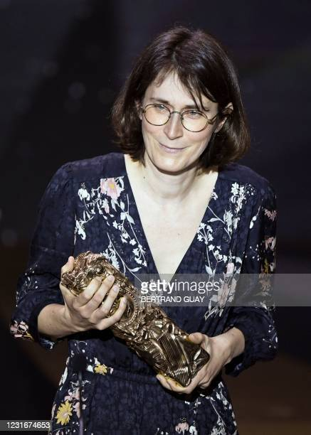 """French film director Agnes Patron holds the trophy after winning the Best Animated Short Film award for """"L'Heure de l'ours"""" during the 46th edition..."""