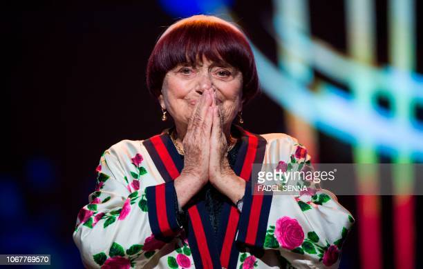 French film director Agnes Varda reacts as she receives a Honorary Award during the 17th Marrakech International Film Festival on December 2 2018