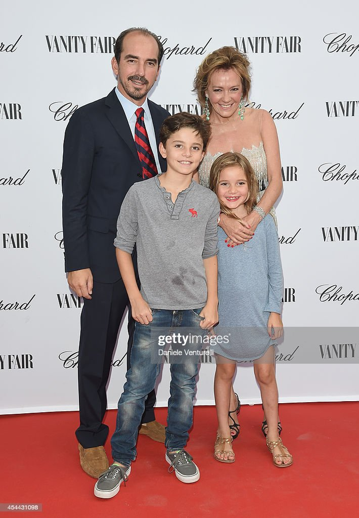 French Film Director and Caroline Scheufele attend the Chopard And Vanity Fair Present 'Backstage At Cinecitta' Exhibition - Red Carpet - 71st Venice Film Festival at Cipriani Hotel on August 31, 2014 in Venice, Italy.