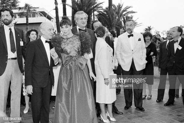 French film director Bertrand Tavernier , and his wife accompanied by actors Louis Ducreux, Sabine Azema, and Philippe Noiret arrive for the...