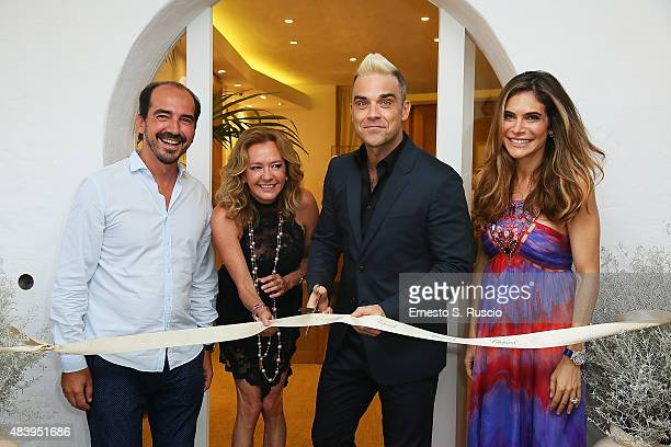 French Film Director Caroline Scheufele Robbie Williams and Ayda Field attend the Chopard Boutique Inauguration at Piazzetta Del Cervo on August 13...