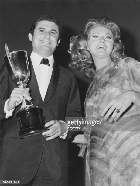 French film director Claude Lelouch receives an award from actress Sylva Koscina during the British Films Festival in Sorrento Italy September 1967