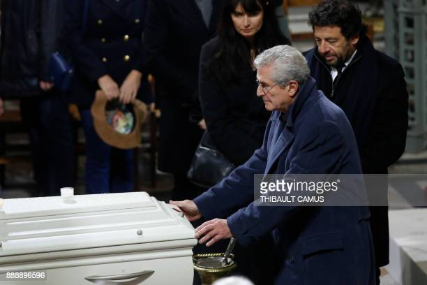 French film director Claude Lelouch singer Patrick Bruel and Lelouch's wife Valerie Perrin pays their last respects during the funeral service of...