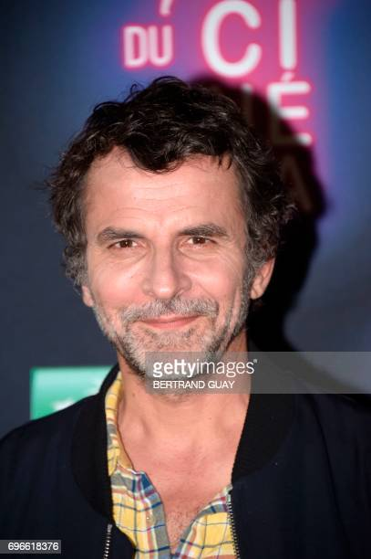 French film director Eric Lartigau poses during a photocall for the press launch of the 33rd edition of the Fete du Cinema at the Cite du Cinema in...