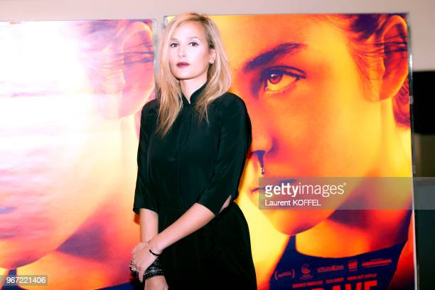 French film director Julia Ducournau poses during a photocall at 'Grave' film premiere at UGC Cine Cite Les Halles cinema on March 14 2017 in Paris...
