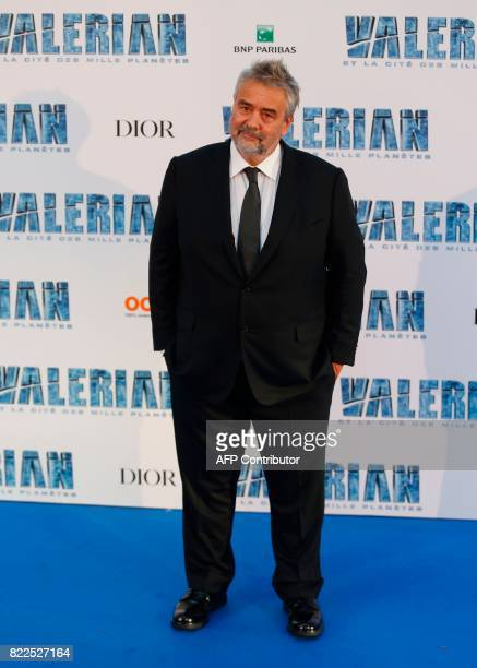 French film director Luc Besson poses for a photograph upon arrival for the prepremiere of the film 'Valerian and The City of a Thousand Planets' in...