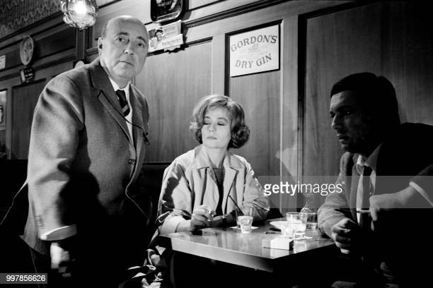 French film director Marcel Carné manages his actors Annie Girardot and Maurice Ronet on the first scene of his new film 'Trois chambres à Manhattan'...