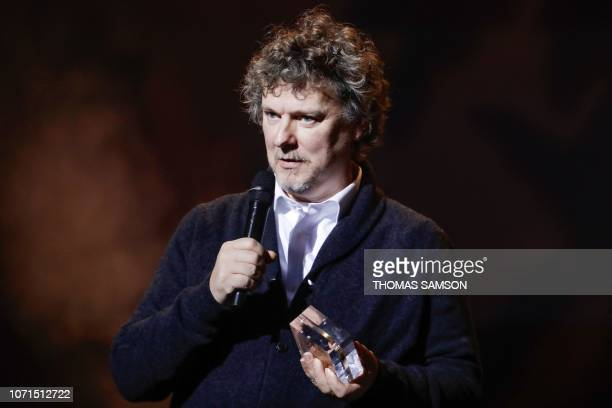 French film director Michel Gondry celebrates after receiving the 'the authordirector of the audiovisual' award during the SACEM Grand Prix awards...