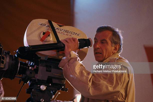 French film director Roger Vadim sets up a shot with a movie camera on the set of And God Created Woman The American film stars Rebecca De Mornay...