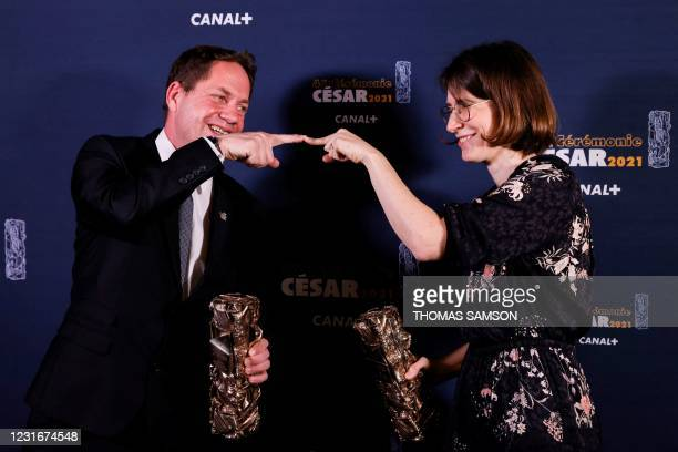 French film producer Ron Dyens and French film director Agnes Patron pose with the trophies after winning the Best Animated Short Film award for...