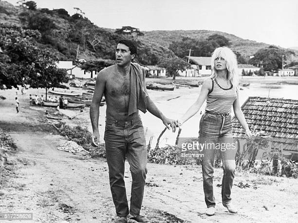 French film queen Brigitte Bardot and her companion BrazilianMorrocan Bob Zaguri stroll hand in hand along the road in this quaint village located on...