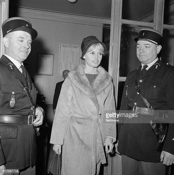 French film sex bomb Brigitte Bardot is not under arrest she simply passes in front of a gendarme on her arrival at Paris Law Courts this morning She...
