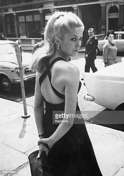 French film star Catherine Deneuve in London for the premiere of her new film 'Repulsion' a thriller directed by Roman Polanski 10th June 1965