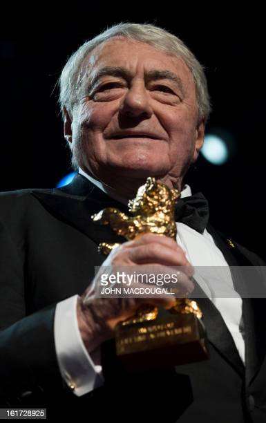 French filmmaker and journalist Claude Lanzmann holds his Honorary Golden Bear during a ceremony at the 63rd Berlinale Film Festival in Berlin...
