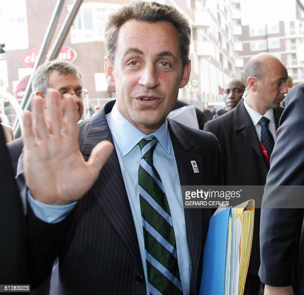 French Finance and Economy Minister Nicolas Sarkozy gestures as he arrives 10 September 2004 at the Kurhaus Hotel near The Hague before a working...
