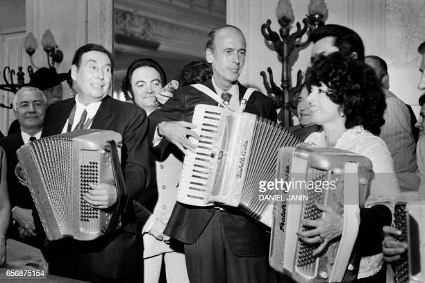 French Finance Minister and candidate for the next presidential elections Valéry Giscard d'Estaing and french musician Yvette Horner play accordion...