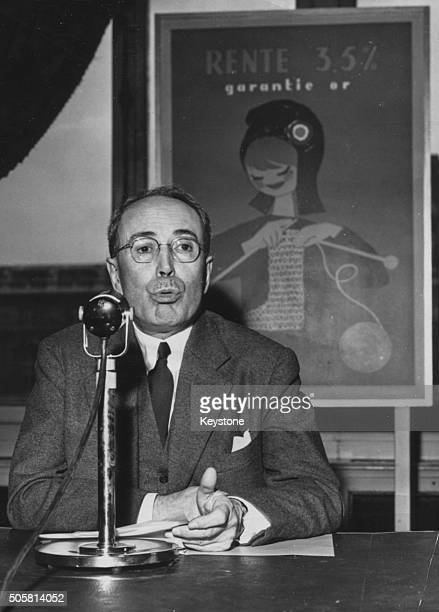 French Finance Minister Antoine Pinay announcing the new state loan at a press conference, at the Ministry in Paris, June 13th 1958.