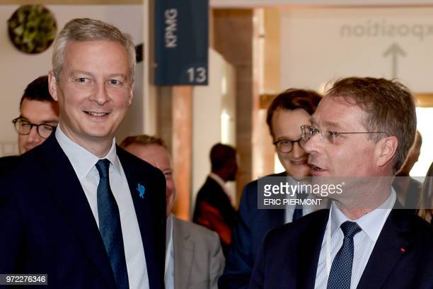 French Finance Minister Bruno Le Maire is greeted by French Confederation of Small and MediumSized Enterprises head Francois Asselin prior to...