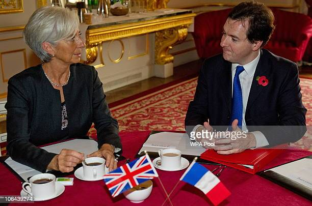French Finance Minister Christine Lagarde and British Chancellor of the Exchequer George Osborne pose for photographers ahead of an AngloFrench...