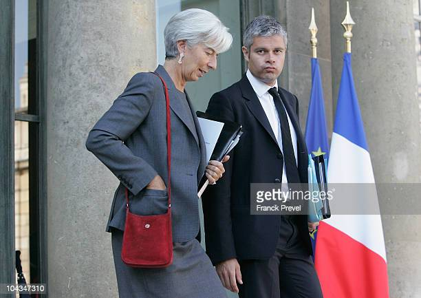 French Finance Minister Christine Lagarde and French Employment Junior Minister Laurent Wauquiez leave the Elysee palace after the weekly cabinet...