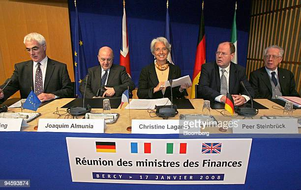 French Finance Minister Christine Lagarde center smiles before the start of a news conference in Paris France on Thursday Jan 17 2008 The meeting was...