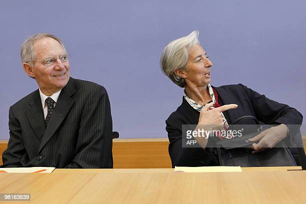 French Finance Minister Christine Lagarde gestures next to her German counterpart Wolfgang Schaeuble during a press conference in Berlin on March 31...