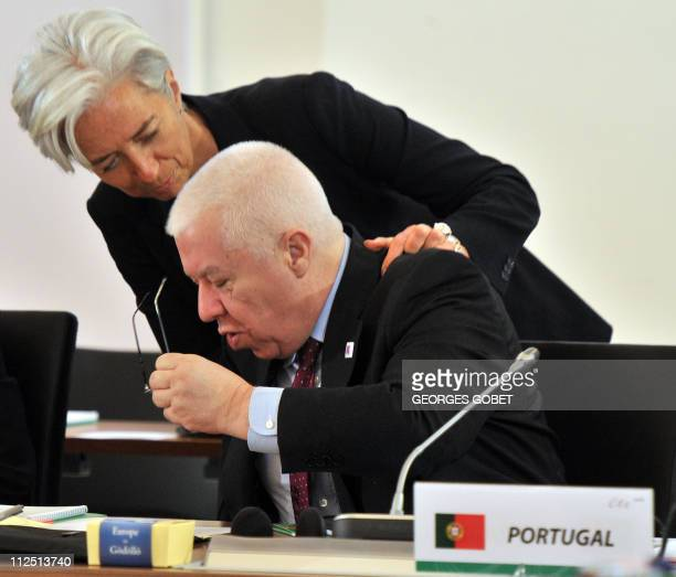 French Finance Minister Christine Lagarde greets her Portuguese counterpart Fernando Teixeira dos Santos on April 8 2011 before an informal meeting...
